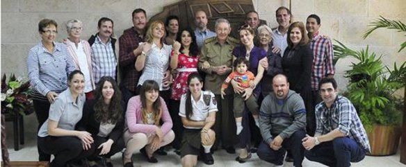 The Cuban Five at home with families and Cuban President Raul Castro/