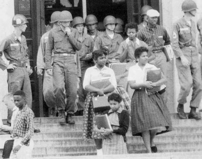 "Federal troops intervene at presidential order to allow ""The Little Rock Nine"" into Arkansas schools during civil rights movement. Ironically, Pres. Bill Clinton interrupted his first campaign to return to Arkansas to preside over the execution of a Black, mentally challenged man."