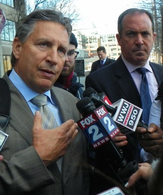 Defense attorney James C. Thomas talks to media including
