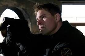 Raid team leader Timothy Dollinger shown as star of A & E's Detroit SWAT.