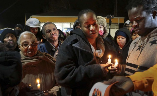 Toni Martin and Jerome Green, parents of Antonio Martin, at candelight vigil after killing.