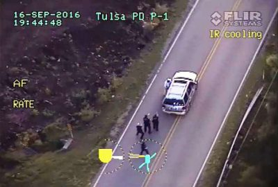 Shot from police helicopter video shows Crutcher at door of his car just before being killed.