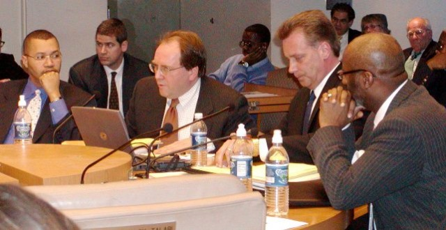 (L to right) Detroit CFO Sean Werdlow, Fitch Ratings' Joe O'Keefe, Standard and Poor's Stephen Murphy, and Detroit Deputy Mayor Anthony Adams press City Council to approve the $1.5 billion COPS loan, on Jan. 31, 2005, Photo: Diane Bukowski