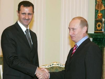 Syrian President Bashar Al-Assad greets Russian President Vladimir Putin in 2006.