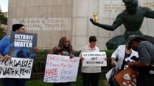 Protesters outside Coleman A. Young Municipal Center May 18 demand a water affordability plan.