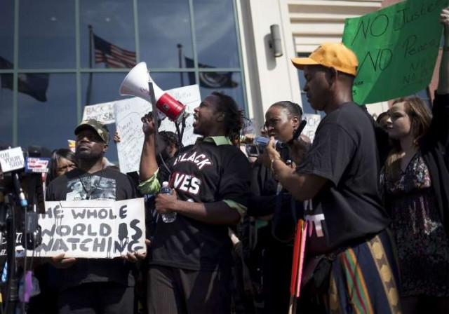 Protesters in Charleston after white cop Michael Slager shot Black man Walter Scott, 51, in the back to death in April, 2015.