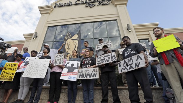Protesters condemn white cop's murder of Walter Scott outside N. Charleston city hall.