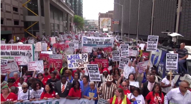 Thousands including many from Canada massed in downtown Detroit July 18, 2014 to protest shut-offs.