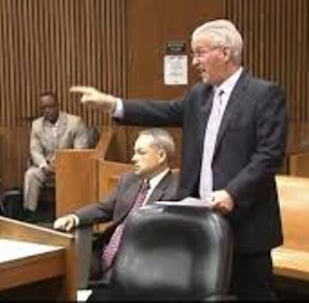 Defense attorney Steve Fishman angrily confronts Aiyana's aunt LaKrystal Sanders during her testimony as Joseph Weekley watches.