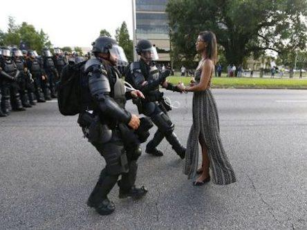 Lone woman confronts Baton Rouge police.