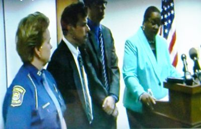 State troopers at Worthy's side during June 9 press conference; they did not comment.