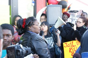 Yvette Falarca (center with bullhorn) speaks at earlier protest against police killing.