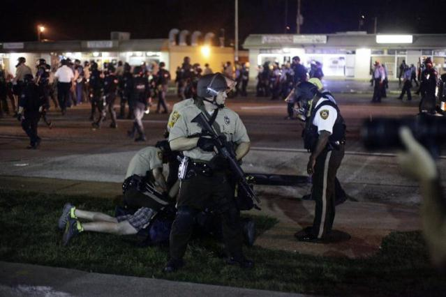Ferguson police detain protester Aug. 18, 2014, nine days after Mike Brown was killed Aug. 9, 2014.