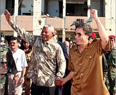 South African President Nelson Mandela and Libyan Pres. Muammar Gadhafi after first U.S. bombing; Hillary Clinton later gave the orders to assassinate Gadhafi in second wave of US/NATO annihilation of Libya.