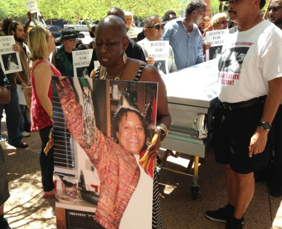 Michelle Cusseaux, 50, was fatally shot August 14, 2014 by Phoenix Police Officer Percy Dupra after, police say, she threatened officers with a hammer when they went to serve a court order to deliver Cusseaux to a mental-health facility. Family and activists demanded an external investigation of the shooting. This didn't happen -- until people marched outside City Hall with Cusseaux's body in a casket on Friday.
