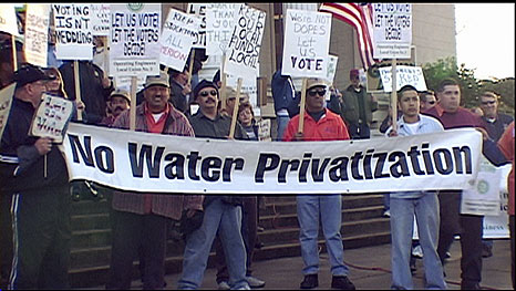 Protesters demand a stop to water privatization.
